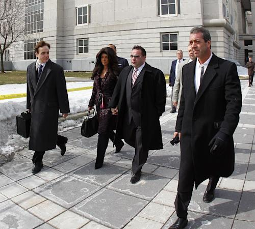 "Teresa, center, left, and Joe Giudice, center right, from ""The Real Housewives of New Jersey,"" leave federal court in Newark, N.J. on Tuesday, March 4, 2014. They each pleaded guilty to several counts including bankruptcy fraud, conspiracy to commit mail fraud and wire fraud, and failing to pay taxes. (AP Photo/Rich Schultz)"