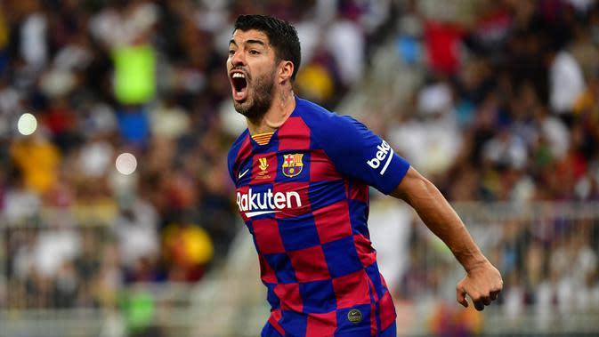 3. Luis Suarez (11 gol) - Luis Suarez berada di posisi ketiga peraihan top skor sementara La Liga di pekan ke-30. Striker asal Uruguay ini telah menyumbangkan 11 gol untuk Barcelona. (AFP/Giuseppe Cacace)