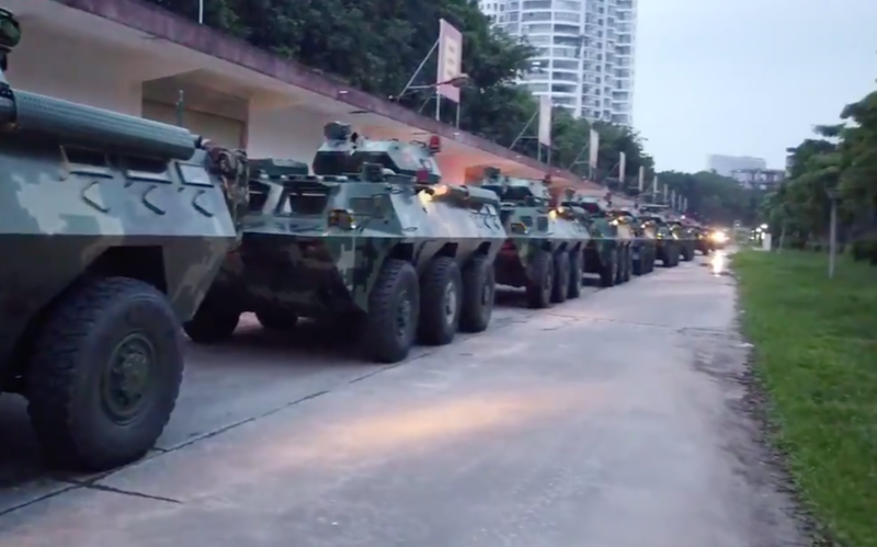 Tanks queue in Shenzhen for what the mainland is calling a drill near the Hong Kong border. Source: China Plus