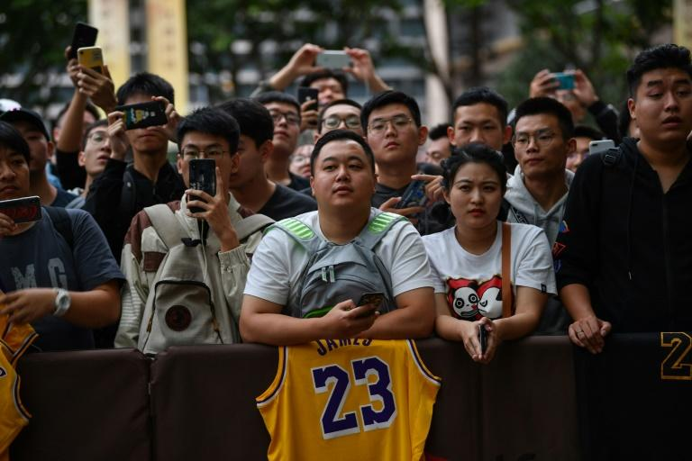 Fans in Shanghai wait outside a hotel for National Basketball Association (NBA) players ahead of a scheduled preseason game in China, where the NBA has built a lucrative fanbase
