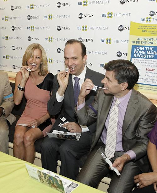 "This image released by ABC shows Lara Spencer , left, ABC News President Ben Sherwood, center, and George Stephanopoulos swabbing themselves at a bone marrow registry drive at ABC News headquarters in New York on Tuesday, June 26, 2012. The national bone marrow donation registry Be The Match reported Tuesday that the rate of new registrants has more than doubled since the ""Good Morning America"" anchor Robin Roberts announced on June 11 that she has MDS, a blood and bone marrow disease. (AP Photo/ABC, Lou Rocco)"