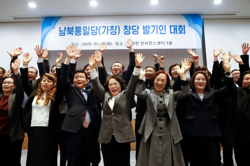 A group of North Korean defectors pose for photographs during the launching ceremony of their political party South-North Unification Party in Seoul