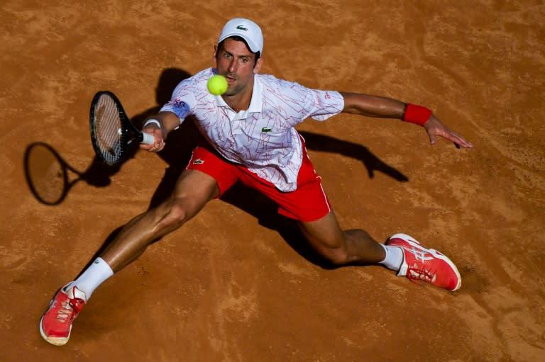 Djokovic wins battle of Serbs to reach Rome quarters