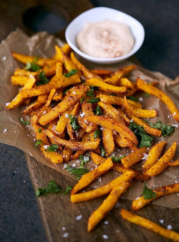 """<p>Who needs potatoes when you have pumpkin? Baked, not fried, <a href=""""http://tasty-yummies.com/spicy-pumpkin-fries-paleo-whole30/"""" target=""""_blank"""" class=""""ga-track"""" data-ga-category=""""Related"""" data-ga-label=""""http://tasty-yummies.com/spicy-pumpkin-fries-paleo-whole30/"""" data-ga-action=""""In-Line Links"""">this simple pumpkin fries recipe</a> is great for people who love healthy snacks. With a spicy kick from the chili seasoning and the chipotle-mayo sauce, you're going to keep coming back for more. </p>"""