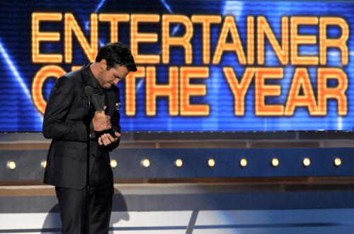 Luke Bryan accepts the award for entertainer of the year at the 48th Annual Academy of Country Music Awards at the MGM Grand Garden Arena in Las Vegas on Sunday, April 7, 2013. (Photo by Chris Pizzello/Invision/AP)