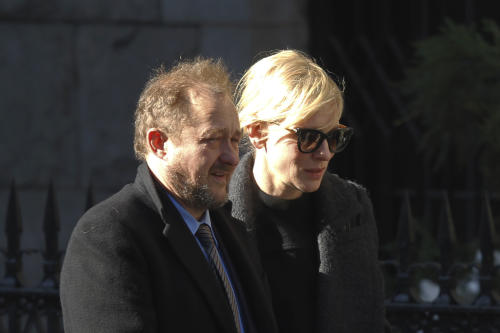 Actress Cate Blanchett and her husband Andrew Upton arrive at the the Church of St. Ignatius Loyola for the private funeral of actor Philip Seymour Hoffman Friday, Feb. 7, 2014, in New York. Hoffman, 46, was found dead Sunday in his Greenwich Village apartment. (AP Photo/Jason DeCrow)