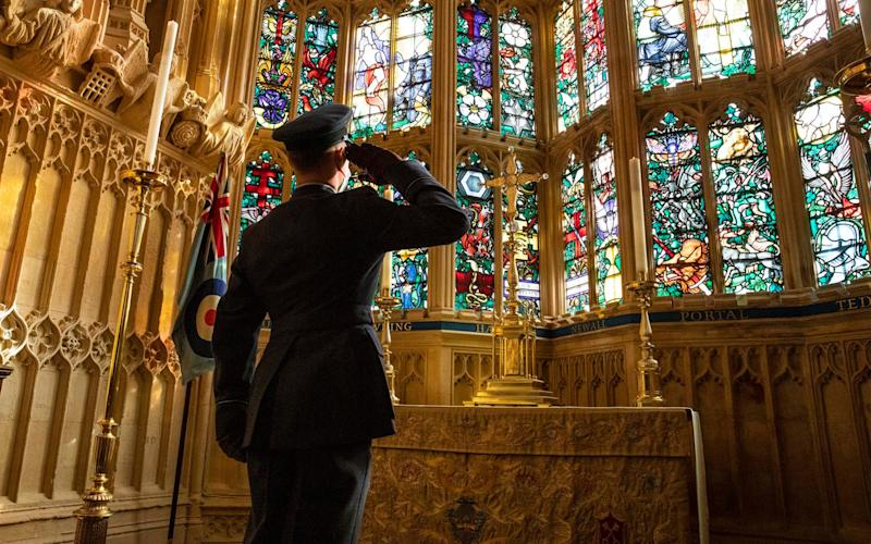 Flying Officer James Buckingham salutes the Battle of Britain memorial window inside Westminster Abbey during a service to mark the 80th anniversary of the Battle. The stained-glass window, by Hugh Easton, contains the badges of the fighter squadrons that took part in the Battle - SAC Connor Tierney/RAF