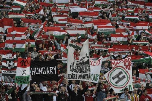 Hungarian fans celebrate at Puskas stadium of Budapest on April 1, 2009