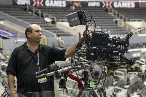 In this Wednesday, June 27, 2012, photo, ESPN coordinating producer Phil Orlins shows a 3-D camera set up used by ESPN 3-D Network coverage at the ESPN X-Games held at the Staples Center in Los Angeles. Only 2 percent of TVs in American homes were able to show 3-D last year, according to IHS Screen Digest. That's about 6.9 million sets out of 331 million installed. (AP Photo/Damian Dovarganes)