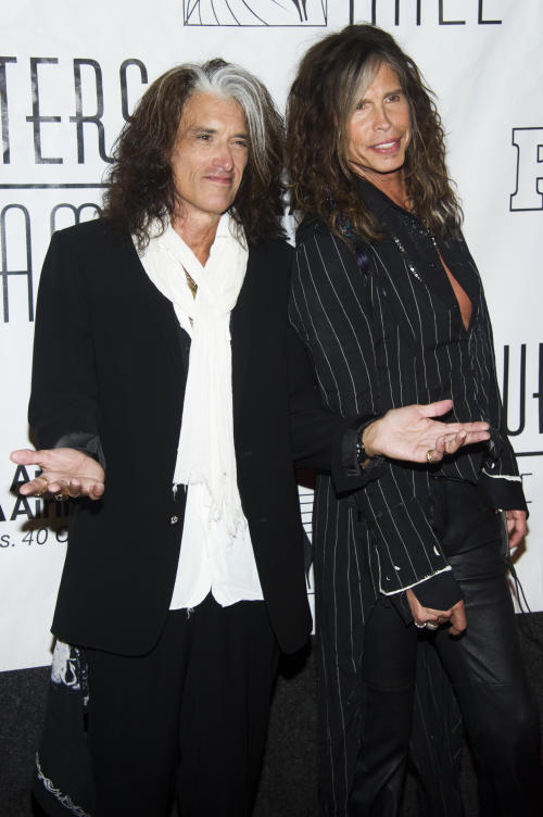 Inductees Joe Perry, left, and Steven Tyler attend the Songwriters Hall of Fame 44th annual induction and awards gala on Thursday, June 13, 2013 in New York. (Photo by Charles Sykes/Invision/AP)