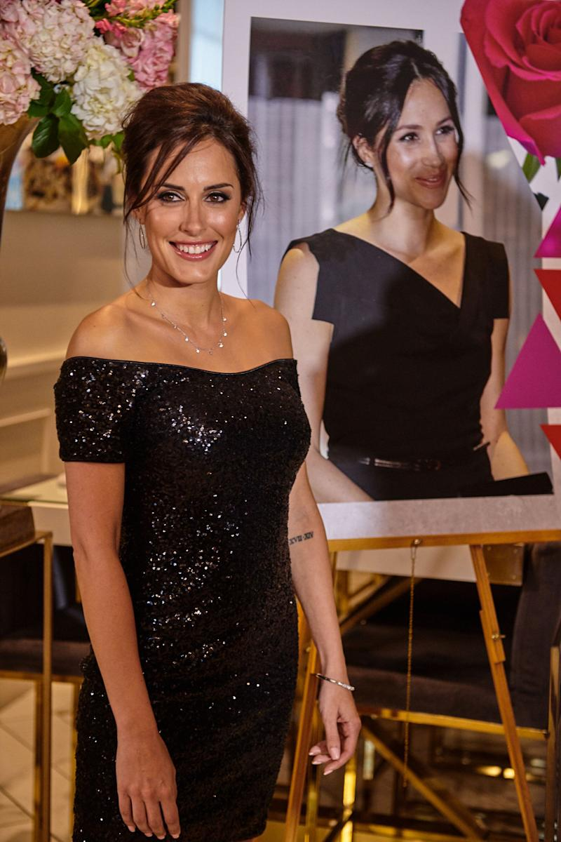 Tanya at her unveiling event revealing her likeness to Meghan Markle. Photo: Caters News