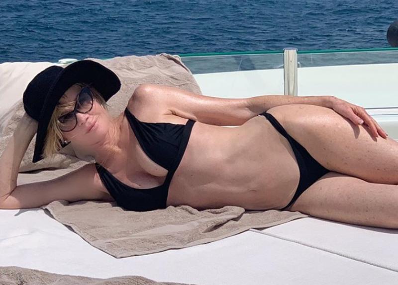 Melanie Griffith rocks a tiny black bikini on holiday in Spain in July