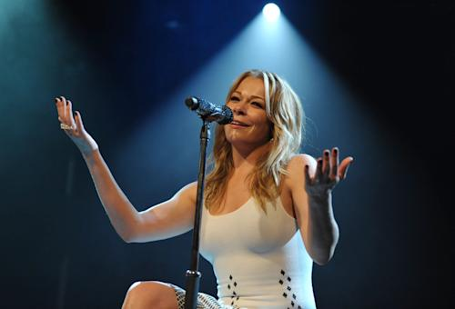 FILE - In this July 1, 2013 file photo, Leann Rimes performs at the Friend Movement Anti-Bullying Benefit Concert at the El Rey Theatre, in Los Angeles. Los Angeles court records show a judge on Monday, Oct. 28, 2013, dismissed an invasion of privacy lawsuit filed by Rimes against two women she claimed illegally recorded a phone conversation with her and posted it online. (Photo by John Shearer/Invision/AP, file)