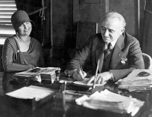 This 1929 photo shows former Memphis, Tenn. movie censor Lloyd Binford at his desk. The woman at left is unidentified. For almost 30 years, Binford had practically total control over which movies were shown in Memphis. He banned films if black actors had anything more than menial roles, and he rejected movies starring actors he personally disliked. (AP Photo/The Commercial Appeal, File)