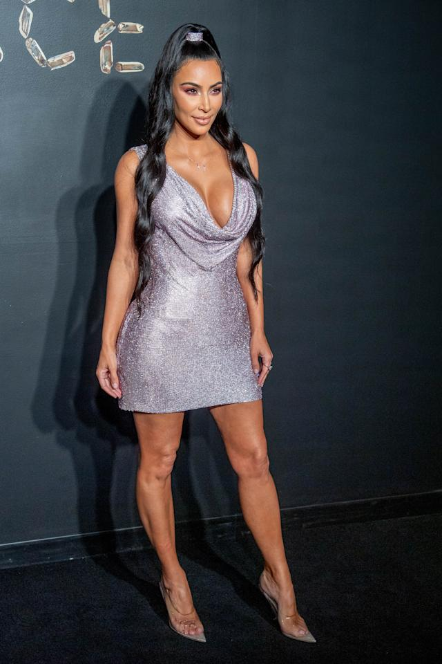 <p>Kim Kardashian turned heads as she stunned wearing this sparkling number – a Versace dress – in New York. Photo: Getty </p>