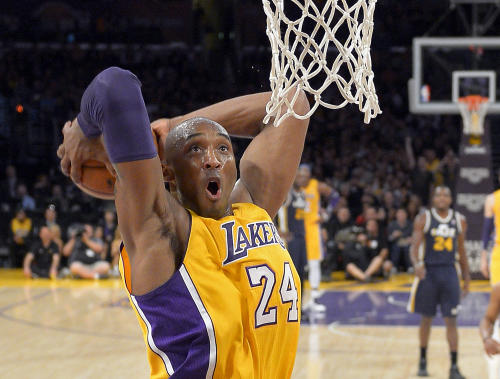 Los Angeles Lakers guard Kobe Bryant goes up for a dunk during the first half of an NBA basketball game against the Utah Jazz, Friday, Jan. 25, 2013, in Los Angeles. (AP Photo/Mark J. Terrill)
