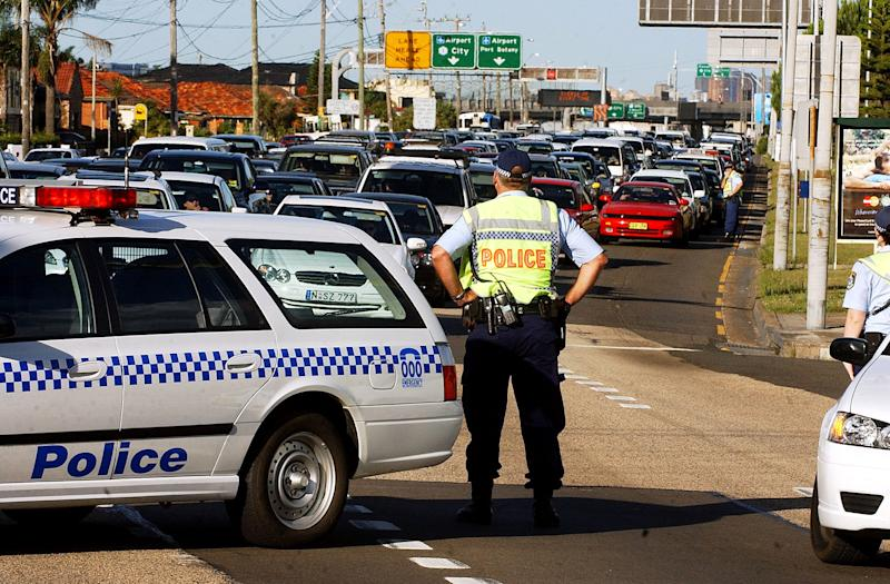 NSW Police block southbound traffic on The Grand Parade, diverting cars into Bestic St, Kyeemagh.