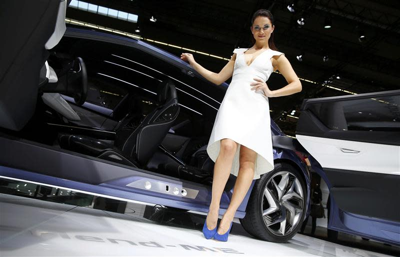 Model poses beside a Nissan 'Friend-Me' concept car at Frankfurt Motor Show