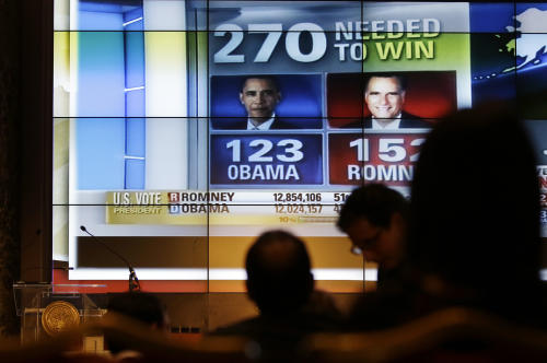 U.S. elections results are broadcasted on a screen during a reception organized by the U.S. embassy on the occasion of the 2012 U.S. Presidential election, in Rome, Wednesday, Nov. 7, 2012. (AP Photo/Gregorio Borgia)