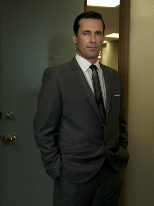 """FILE - In this file image released by AMC, Jon Hamm stars as Don Draper in """"Mad Men."""" Hamm was nominated for an Emmy award for outstanding lead actor in a drama series, Thursday, July 19, 2012, for his role in """"Mad Men."""" The 64th annual Primetime Emmy Awards will be presented Sept. 23 at the Nokia Theatre in Los Angeles, hosted by Jimmy Kimmel and airing live on ABC. (AP Photo/AMC, FILE)"""