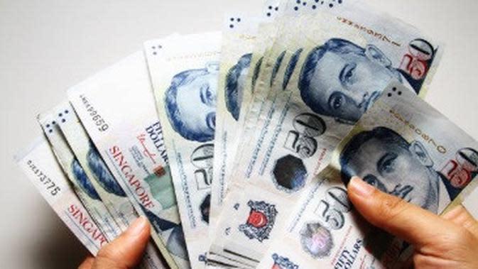 Ilustrasi uang. (iStockphoto)