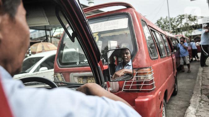 Polisi Buat Selebaran untuk Angkot soal Aturan Penumpang Saat PSBB Ketat DKI
