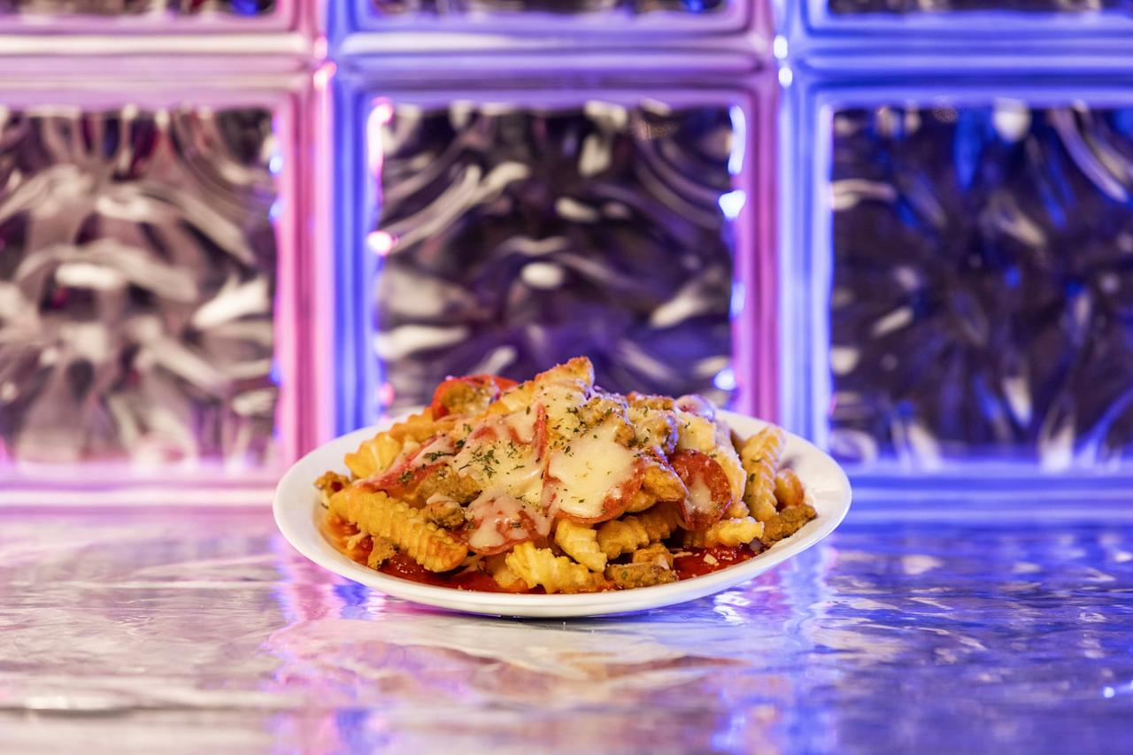 <p>A true '80s delicacy, these pizza fries are sprinkled with sausage crumbles, pepperoni slices, marinara sauce, and loads of cheese. Yum!  </p>