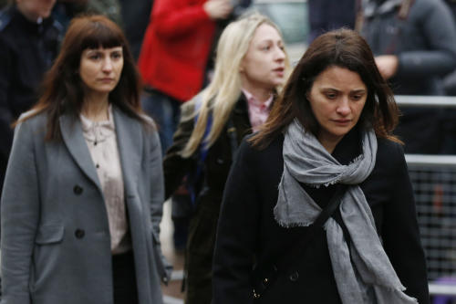 Elisabetta Grillo, foreground, and Francesca Grillo, left, arrive at Isleworth Crown Court in London, Wednesday, Dec. 4, 2013. Celebrity chef Nigella Lawson could face questions Wednesday about alleged drug use when she appears as a witness at the fraud trial of her former personal assistants. Lawson is due to testify as a prosecution witness against Italian sisters Elisabetta and Francesca Grillo. The pair are accused of living the high life by using credit cards loaned to them by Lawson and her ex-husband Charles Saatchi. (AP Photo/Sang Tan)