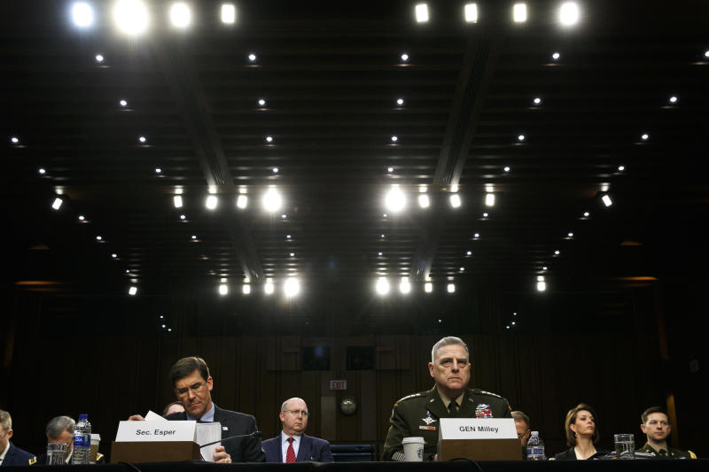 Defense Secretary Mark Esper, left, and Chairman of the Joint Chiefs of Staff Gen. Mark Milley, listen during a Senate Armed Services Committee on budget posture, Wednesday, March 4, 2020, on Capitol Hill in Washington. (AP Photo/Jacquelyn Martin)