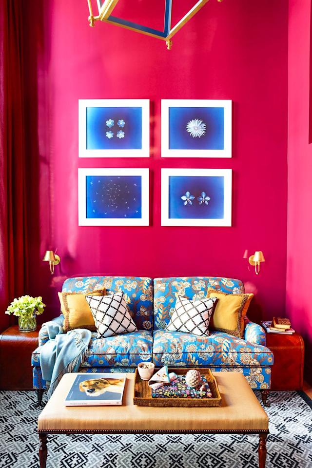 """<p>Proof that opposites attract, this neon pink and bright blue living room designed by <a href=""""https://www.katieridder.com/"""" target=""""_blank"""">Katie Ridder</a> is absolute color palette goals.  The intense, eye-catching, and adventurous shade of pink, Mulberry from C2 Paints, makes the blue sofa and gallery wall pop even more.<a href=""""https://pinterest.com/pin/create/button/?url=https%3A%2F%2Fwww.housebeautiful.com%2Froom-decorating%2Fcolors%2Fg1181%2Fliving-room-paint-color-ideas%2F&description=Olive&media=https%3A%2F%2Fhips.hearstapps.com%2Fhbu.h-cdn.co%2Fassets%2F15%2F22%2F1432832254-den.jpg%3Fresize%3D1600%3A%2A"""" target=""""_blank""""></a></p>"""