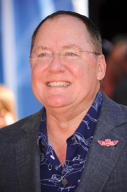 """FILE - In this Aug. 5, 2013 file photo, Chief Creative Officer at Walt Disney and Pixar Animation Studios, John Lasseter, arrives at the world premiere of """"Disney's Planes"""" at the El Capitan Theatre, in Los Angeles. With more than 5,000 fans expected to attend, Disney is teasing several of the studio's upcoming animated movies at the D23 Expo, a three-day celebration of all things Disney at the Anaheim Convention Center. On the animation front, the studio will showcase Walt Disney Animation Studios' computer-generated adventure """"Frozen"""" and Pixar's prehistoric comedy """"The Good Dinosaur"""" during a Friday presentation, as well as the """"Finding Nemo"""" sequel """"Finding Dory,"""" the manga-style Marvel adaptation """"Big Hero 6"""" and the new Mickey Mouse short film """"Get a Horse!"""" (Photo by Richard Shotwell/Invision/AP, File)"""