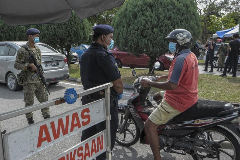 A motorcyclist is stopped at a roadblock at Taman Sri Andalas in Klang October 10, 2020. — Picture by Shafwan Zaidon