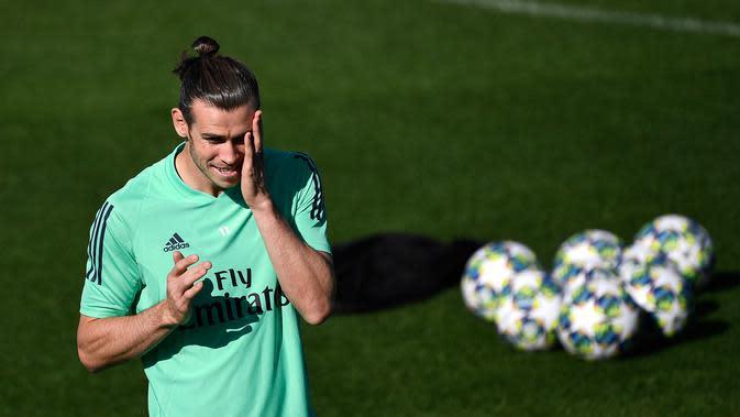 Penyerang Real Madrid Gareth Bale saat sesi latihan di kompleks latihan Valdebebas, Madrid, Spanyol, Senin (30/9/2019). Real Madrid bersiap jelang menjamu Club Brugge dalam laga Liga Champions. (PIERRE-PHILIPPE MARCOU/AFP)