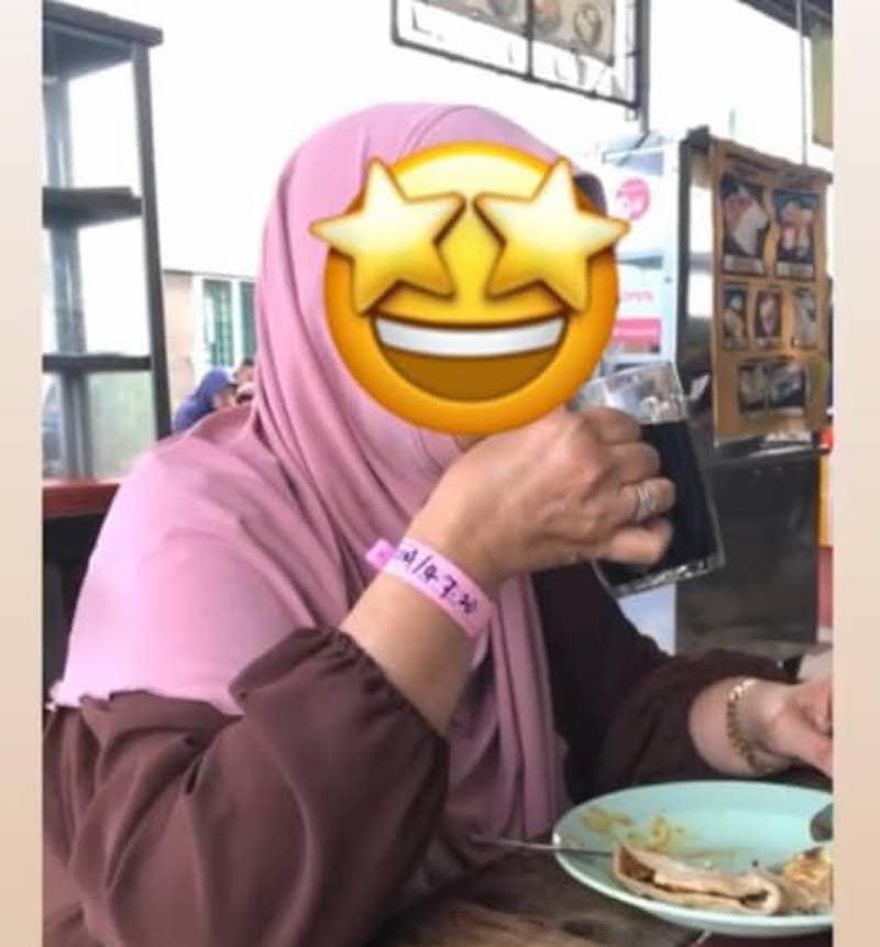 A picture of a woman wearing a Covid-19 quarantine wrist tag and dining at a restaurant in Bandar Meru Raya made the rounds on social media. — Picture from social media