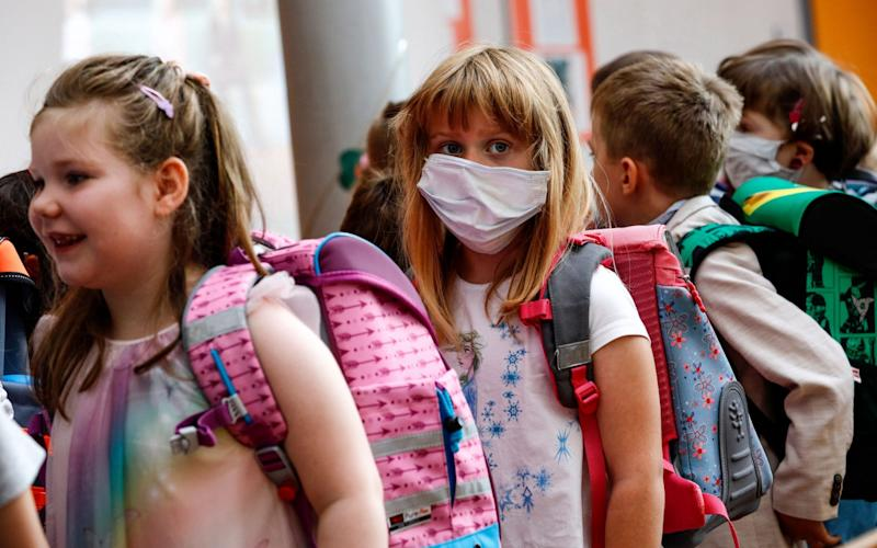 A new pupil wears a sanitary mask during an enrolment ceremony in the Lankow elementary school in Schwerin, Germany - FELIPE TRUEBA/EPA-EFE/Shutterstock/Shutterstock