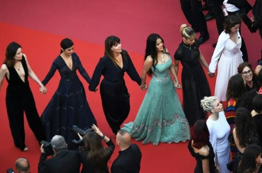 Female actresses including Salma Hayek Pinault, wearing sea green, and Sofia Boutella, on her left, protest the lack of female filmmakers honored at Cannes film festival