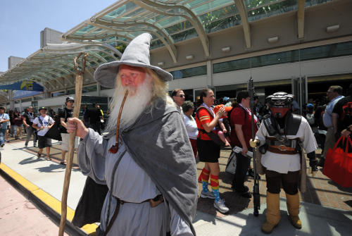 Wilfred Harris, dressed as Gandalf, walks out of the San Diego Convention center on Day 2 of the 2013 Comic-Con International Convention on Thursday, July 18, 2013, in San Diego. (Photo by Denis Poroy/Invision/AP)