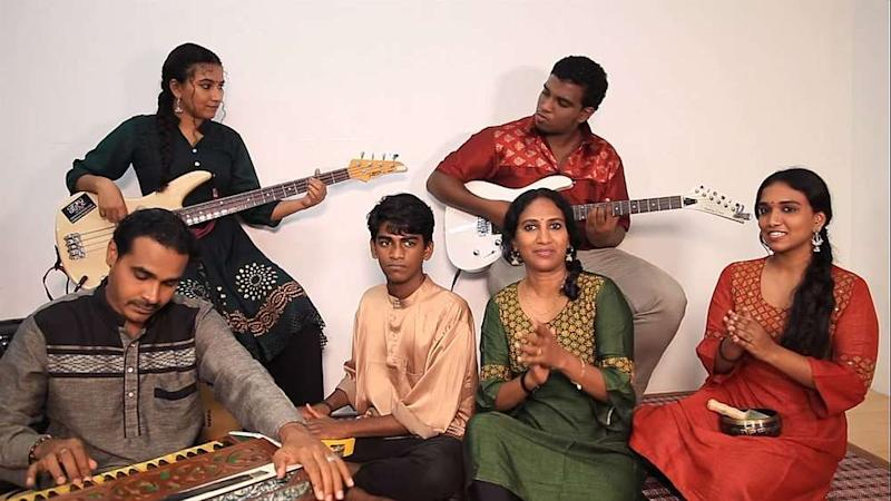 Savithri (sitting, in green) together with family members as they sing the Hari Raya song using a variety of musical instruments. — Facebook/UniqueArtsCultureandHeritageMalaysia