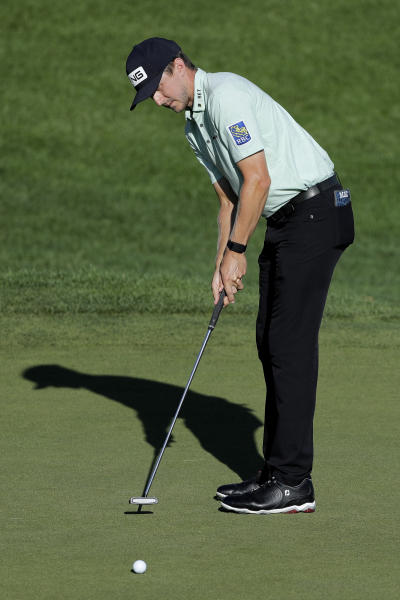 Mackenzie Hughes, of Canada, putts on the 18th green during the second round of the Travelers Championship golf tournament at TPC River Highlands, Friday, June 26, 2020, in Cromwell, Conn. (AP Photo/Frank Franklin II)