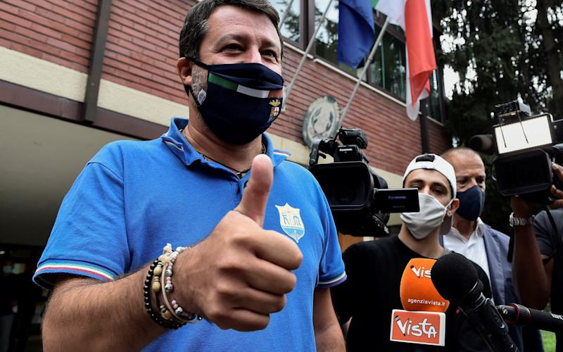 The leader of Italy's far-right League party Matteo Salvini gestures after casting his ballot on a referendum to sanction a proposed cut in the number of Italian parliamentarians - FLAVIO LO SCALZO/REUTERS