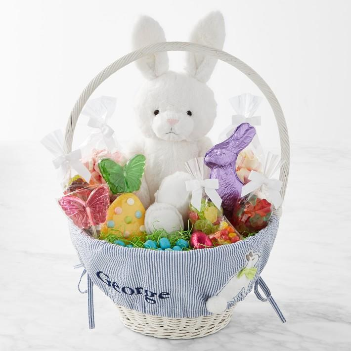 """<p><strong></strong></p><p>williams-sonoma.com</p><p><strong>$159.95</strong></p><p><a href=""""https://go.redirectingat.com?id=74968X1596630&url=https%3A%2F%2Fwww.williams-sonoma.com%2Fproducts%2Fwilliams-sonoma-pottery-barn-kids-large-seersucker-easter-basket&sref=https%3A%2F%2Fwww.townandcountrymag.com%2Fleisure%2Fdining%2Fg18567353%2Fbest-pre-made-easter-baskets%2F"""" target=""""_blank"""">Shop Now</a></p><p>This sweet and pastel pre-made Easter basket is monogrammed for all of your little prepsters. It arrives filled to the brim with cookies, chocolate bunnies, and candy, as well as a fluffy bunny toy. </p>"""