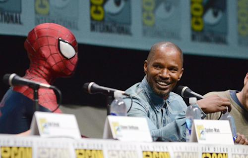 "Spider-Man, left, and Jamie Foxx attend the ""The Amazing Spider-Man 2"" panel on Day 3 of Comic-Con International on Friday, July 19, 2103 in San Diego. (Photo by Jordan Strauss/Invision/AP)"
