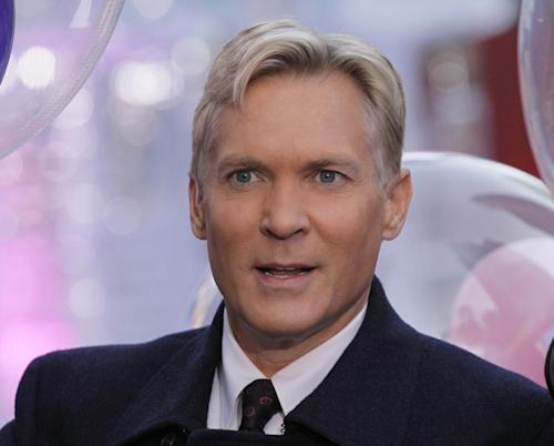 "This Oct. 17, 2012 photo shows Sam Champion, the weather anchor of ABC's ""Good Morning America"" program in New York's Times Square. Weather Channel President David Clark announced Monday, Dec. 2, 2013, that Champion will anchor the network's new flagship morning show, which is set to debut in early 2014. Champion, who will be based at the Weather Channel headquarters in Atlanta, will also assume managing editor responsibilities at the network. His last day on ""GMA"" is Wednesday. He had been on that program since 2006. He joined local New York station WABC in 1988. (AP Photo/Richard Drew)"