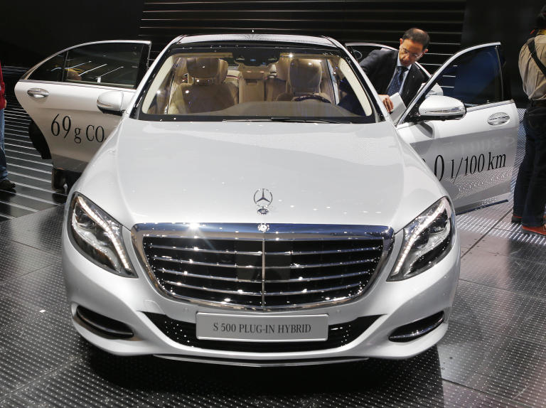 A man disembarks from a Mercedes S 500 Plug-in Hybrid during the second press day of the 65th Frankfurt Auto Show in Frankfurt, Germany, Wednesday, Sept. 11, 2013. More than 1,000 exhibitors will show their products to the public from Sept. 12 through Sept.22, 2013. (AP Photo/Michael Probst)