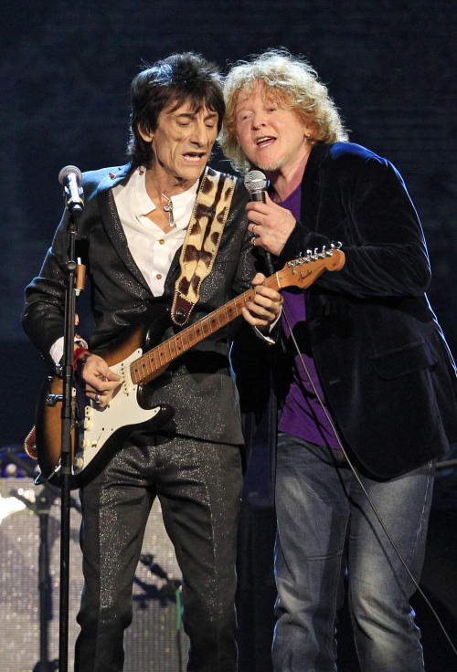 Ron Wood, left, performs with Simply Red lead singer Mick Hucknall after The Small Faces/Faces were inducted into the Rock and Roll Hall of Fame Saturday, April 14, 2012, in Cleveland. Hucknall subbed for Faces member Rod Stewart who was ill. (AP Photo/Tony Dejak)