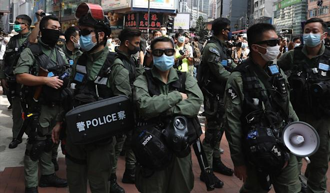 Police officers clamp down on protests in Causeway Bay on Thursday. Photo: Nora Tam