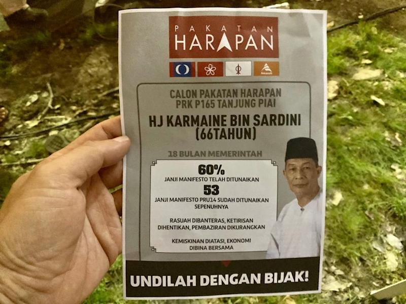 The Pakatan Harapan (PH) flyer on the front featuring information calling on Muslims to vote for Karmaine Sardini has been making its rounds at the ruling coalition's Ceramah Mega in Kukup here November 13, 2019. — Pix by Ben Tan