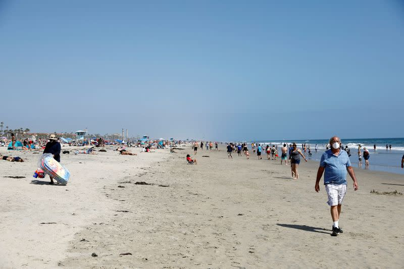 People at the beach on Memorial Day weekend during the outbreak of the coronavirus disease (COVID-19) in Huntington Beach, California