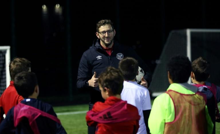 Deaf football coach Ben Lampert takes a training session in west London