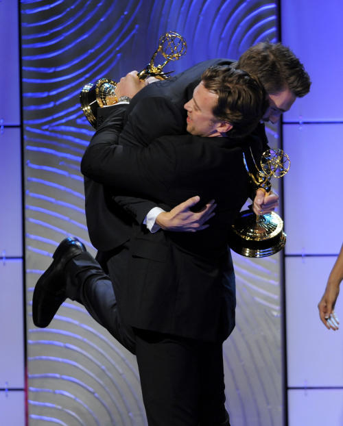 "Scott Clifton, left, from the cast of ""The Bold and the Beautiful,"" congratulates co-winner Billy Miller, from the cast of ""The Young and the Restless,"" as they accept the award for outstanding supporting actor in a drama series at the 40th Annual Daytime Emmy Awards on Sunday, June 16, 2013, in Beverly Hills, Calif. (Photo by Chris Pizzello/Invision/AP)"